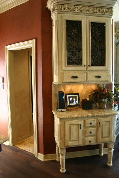 Love this idea. Upper cabinet hides security system and ...