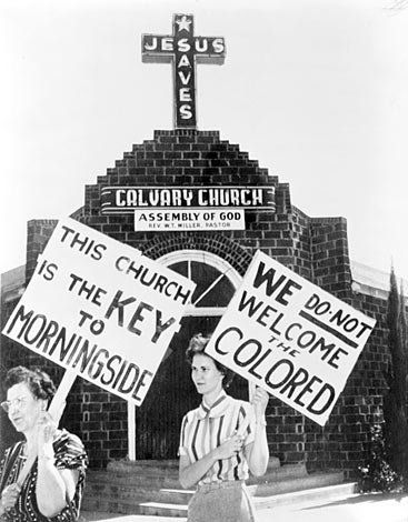 """""""Z.T. Holden and Peggy Richard picket the Calvary Assembly of God Church in Fort Worth, Texas, after its pastor sold the building to a Black congregation in 1956"""""""