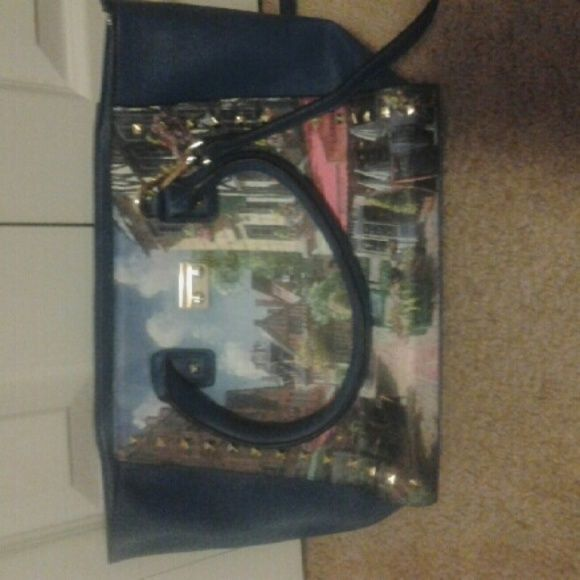 Look a like Nicole lee! Its a nice large bag but the lock is broken but it zips an no damage othere then the lock part is broken ... Nicole Lee Bags Shoulder Bags