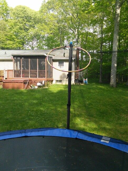 Homemade Basketball Hoop Hoola Hoop And A Trampoline Backyard Backyard Playground Outdoor Landscaping