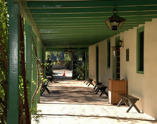 Los Cerritos Adobe Rancho, beautiful long galleria.  Love the dark green.
