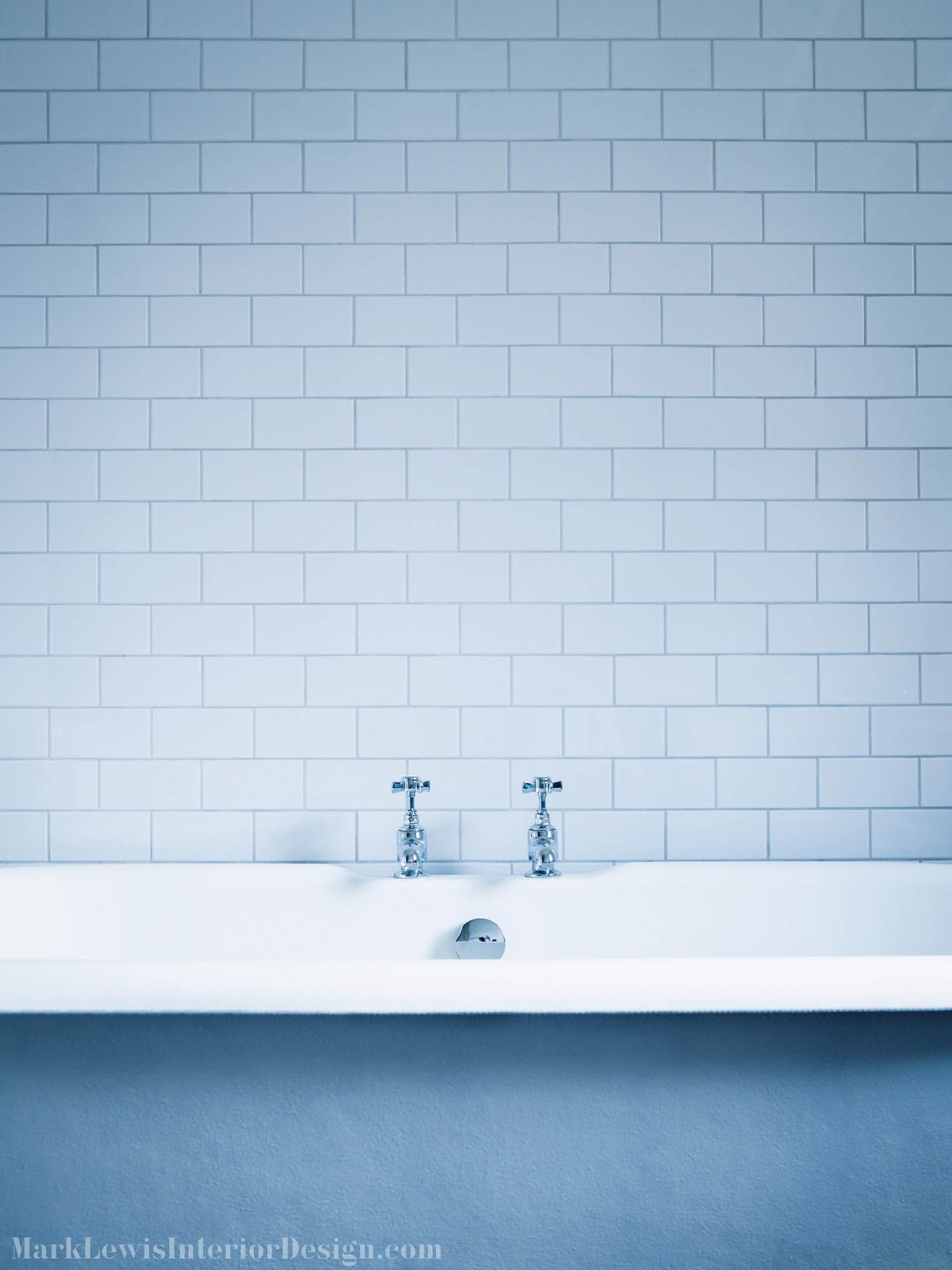 The atmosphere of a bathroom from a previous era is complete with a ...