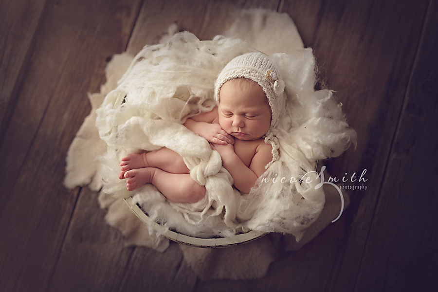 What a sweet bowl pose with babys legs stacked like that nicole smith photography