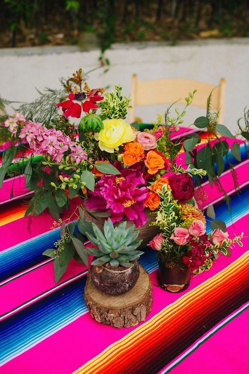 Mexican themed wedding decor ideas that will floor you colorful colorful centerpieces mix flowers and cactuses on top of a mexican sarape belmont dallas photography amber vickery junglespirit Images