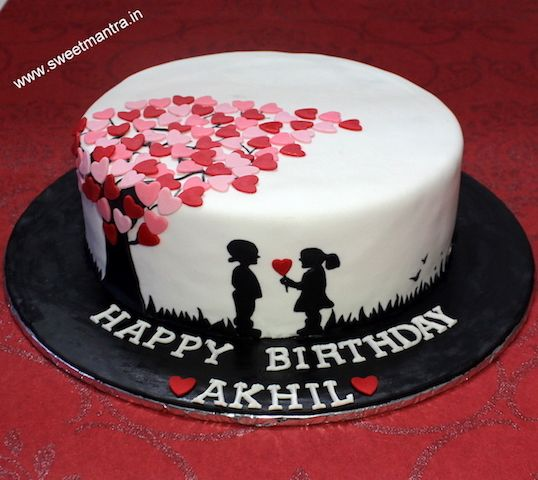 Love Anniversary Theme Small Customized Designer Fondant Cake With Girl Giving Away Heart To Boy Silhouette