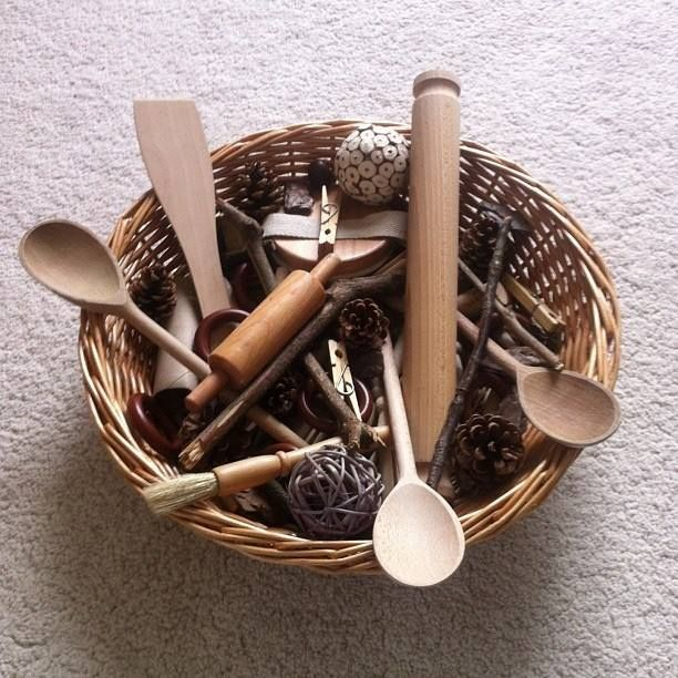 This wooden treaure basket would be good for the children because it has real  materials that familes have at home. Children can get more familar with them and use them by copying how they see them being used at home.