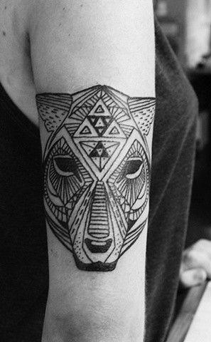 Triangles making up a cheetah. Geometric tattoo.