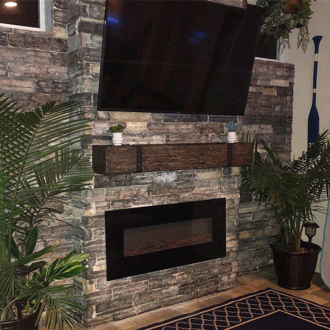Rustic fireplace mantel with metal straps u bolts custom made to