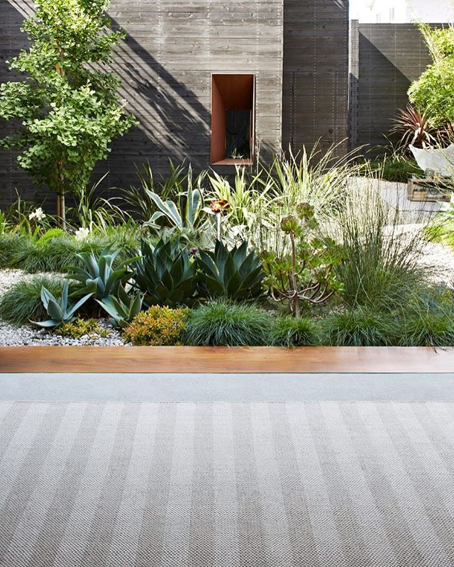WEBSTA @ armadilloandco - The perfect balance between built and soft elements within a garden to create a tranquil space. Featuring our Harvest Weave rug in Granite