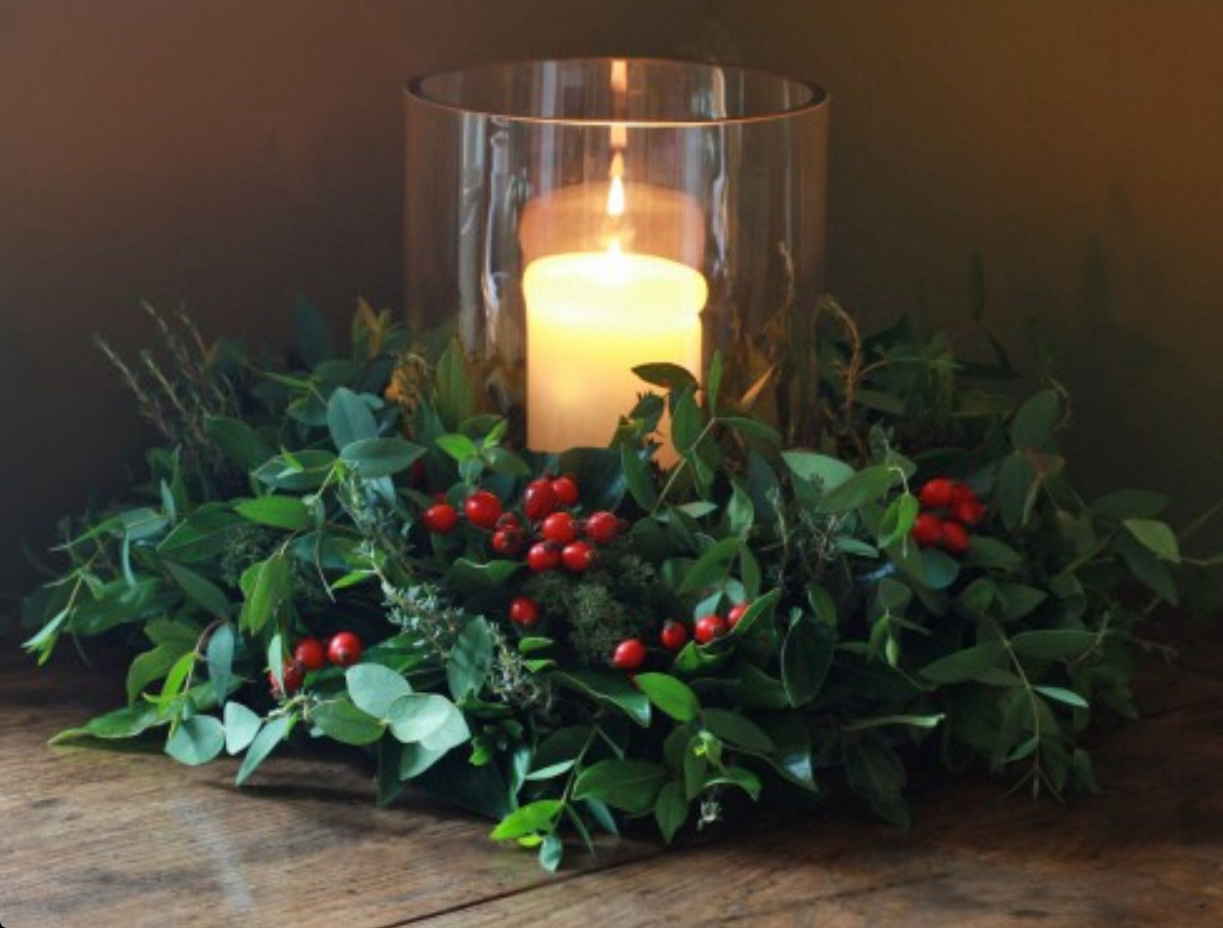 Holly Berries And Candles Christmas Table Centerpieces Christmas Flowers Christmas Table Decorations