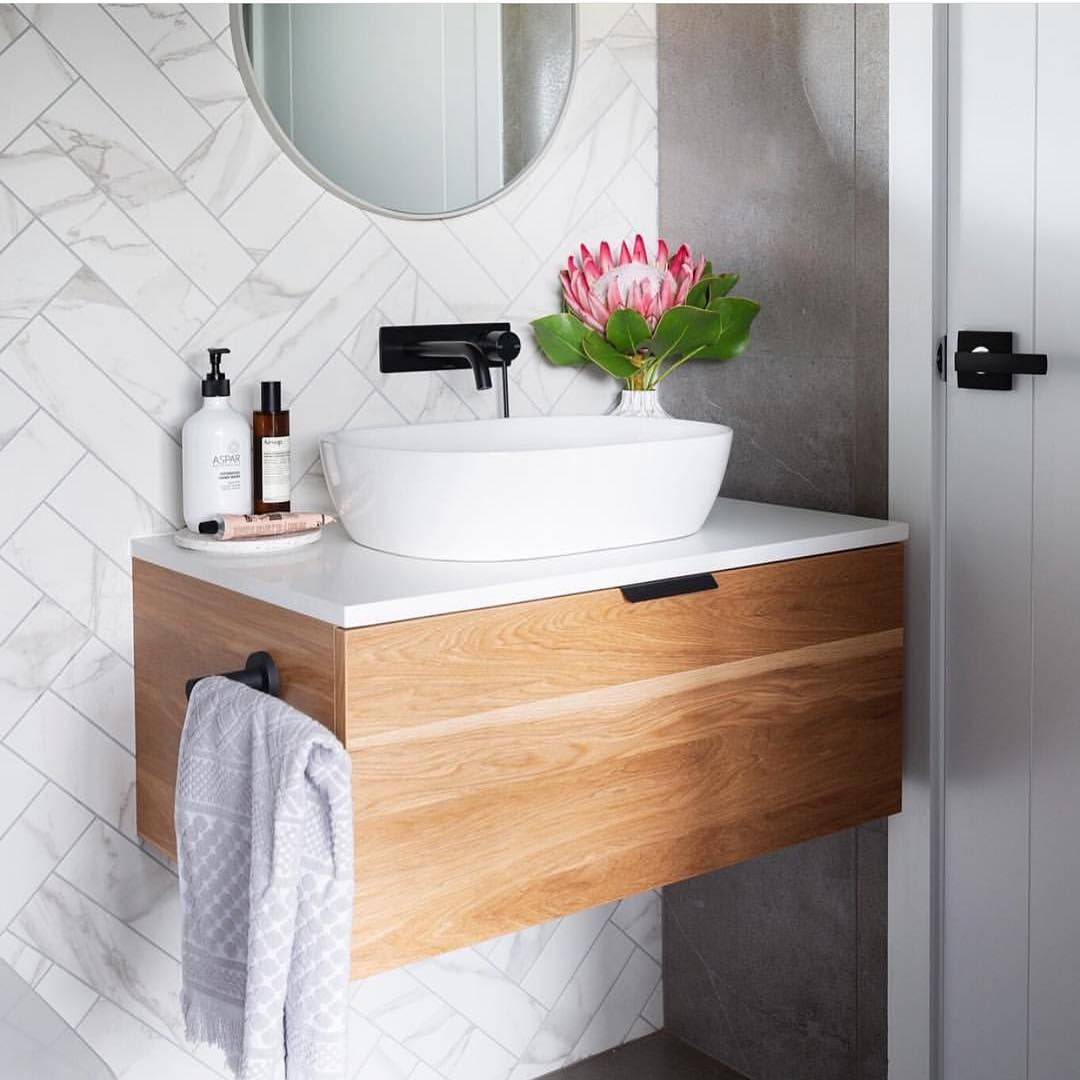 Keep it simple, but significant ✨ This is the guest/powder room at our recently complete custom home in Denman Prospect. Visit our website… #modernpowderrooms