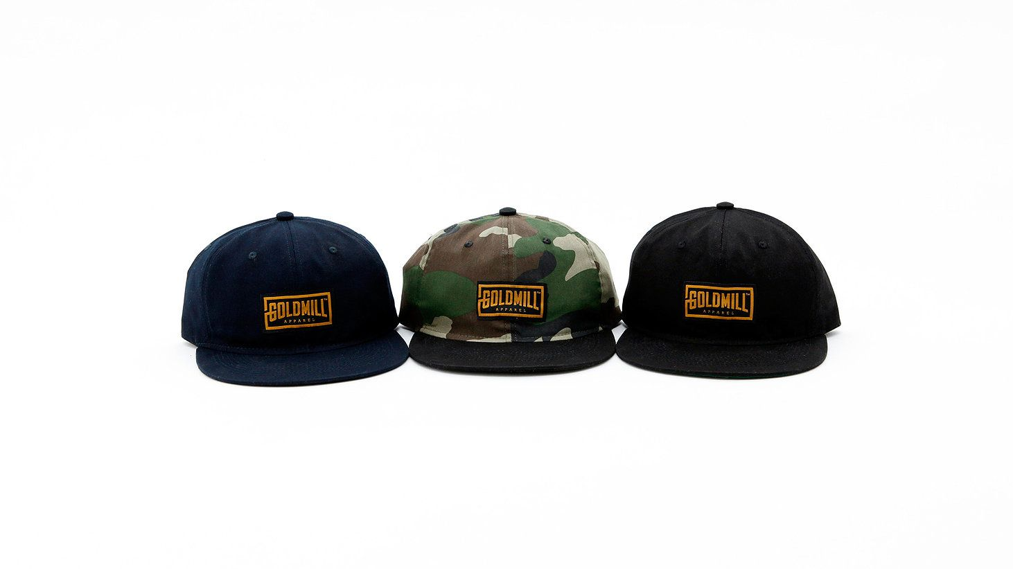 Unstructured 6 panel snapback cap in 3 colors, made of 100% cotton, with woven Goldmill Apparel logo patch.