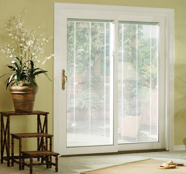 sliding glass doors with blinds inside them sliding patio doors