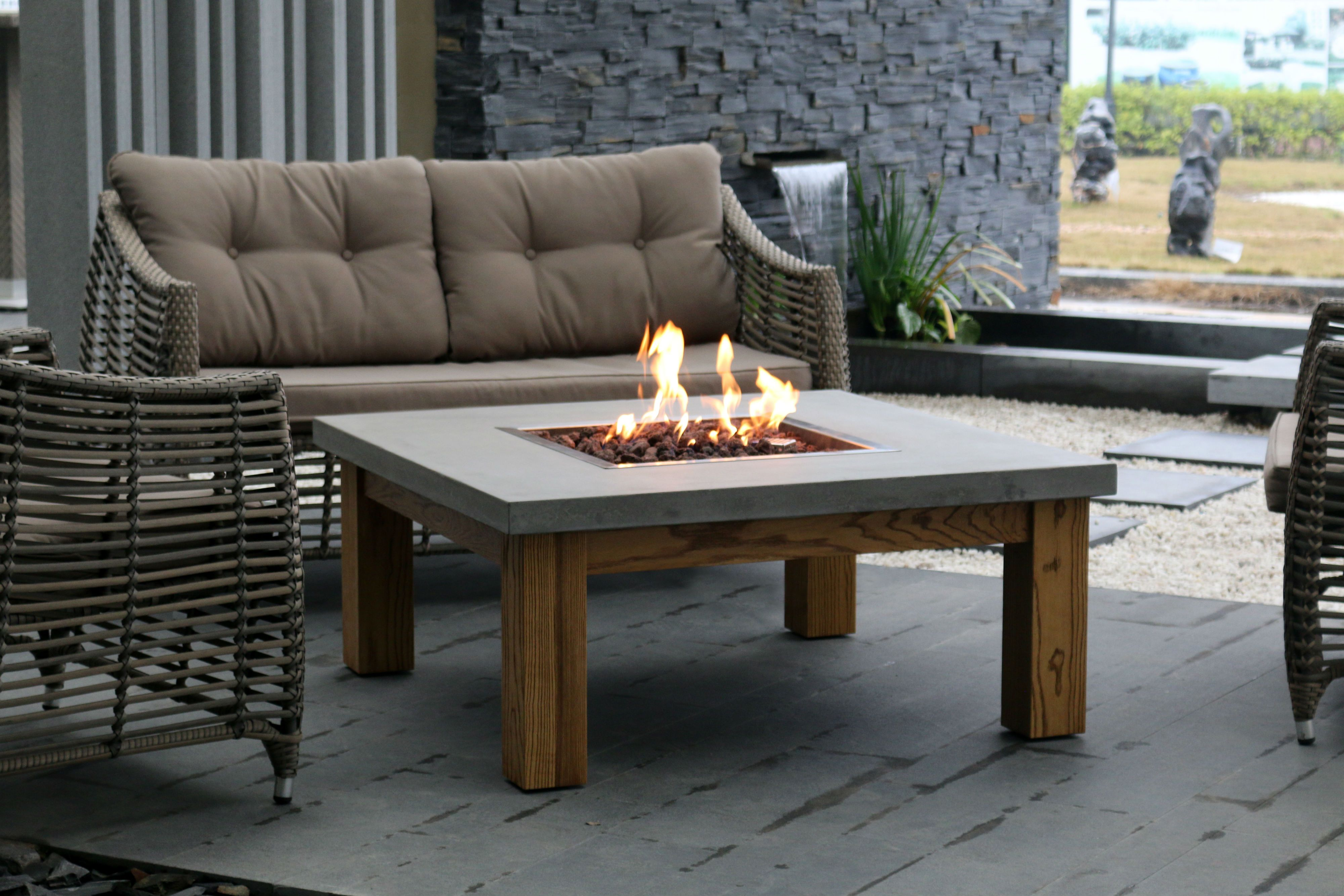 The Elementi Amish Table Fire Pit Combines A Cast Concrete Top And