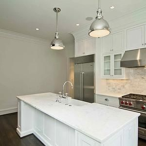 Kitchens glass front cabinets swing arm pot filler bridge faucet also lovely sun filled kitchen with walls in ivory paint and generous