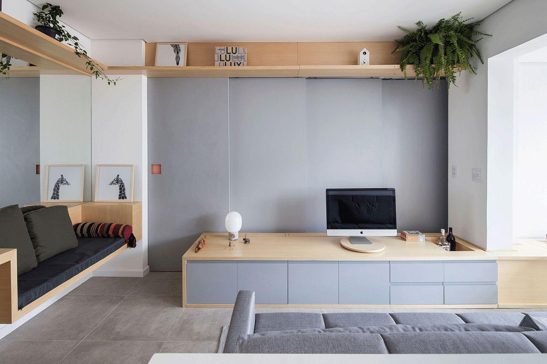 Schiebetüren und multifunktionale Wandform Tiny São Paulo Apartment