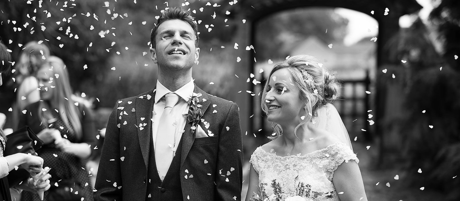 asian wedding photography east midlands%0A bride and groom in shower of confetti   Guildford wedding photographer  Chris Mann