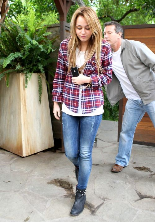 Boots, Light wash jeans, red flannel, plain white tee.
