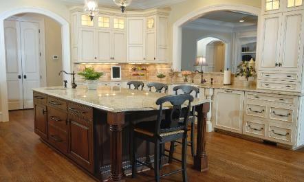 off white glazed kitchen cabinets / dark island. granite ties them