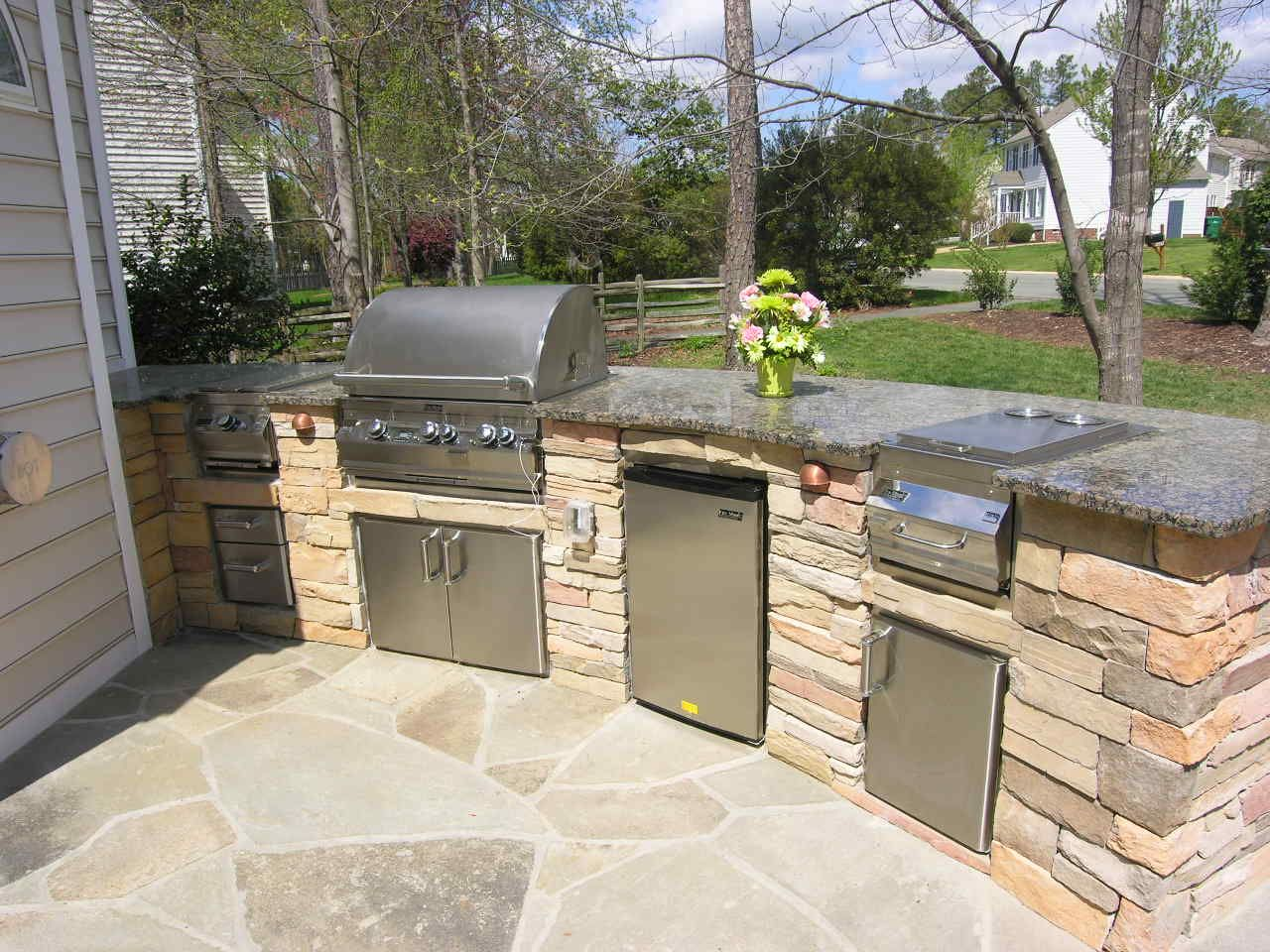 Backyard patio with kitchen ideas this custom outdoor for Outdoor kitchen cabinets plans