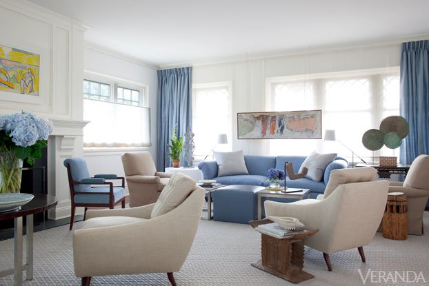 In the living room, a 19th-century Chinese chest mingles with stainless steel and limestone coffee tables and an English-style sofa. The two main seating areas--one for group socializing, the other more intimate--are linked by streamlined, midcentury modern--Max Kim-Bee  - Veranda.com