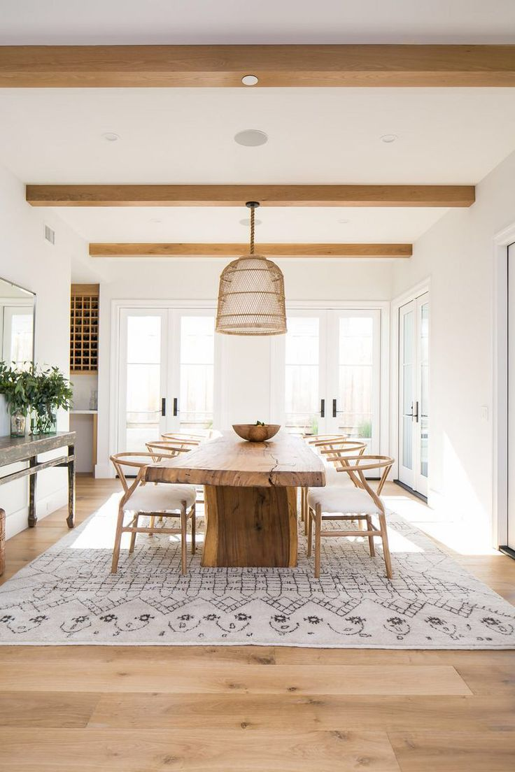 Modern minimal dining room with basket woven chandelier, live edge ...