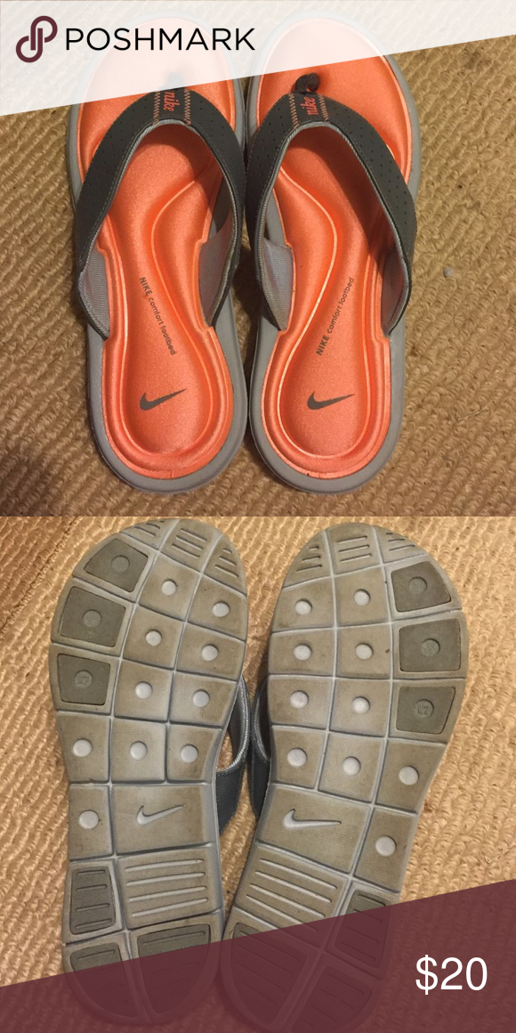 141cdf4438057 Nike flip flops Gray and orange memory foam flip flops. Very comfortable.  Just don t fit me. Worn once. Nike Shoes Sandals