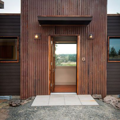 Great Example Of Corten Siding Paired With Dark Gray Matte Black Siding Steel Siding Metal Buildings Metal Building Designs