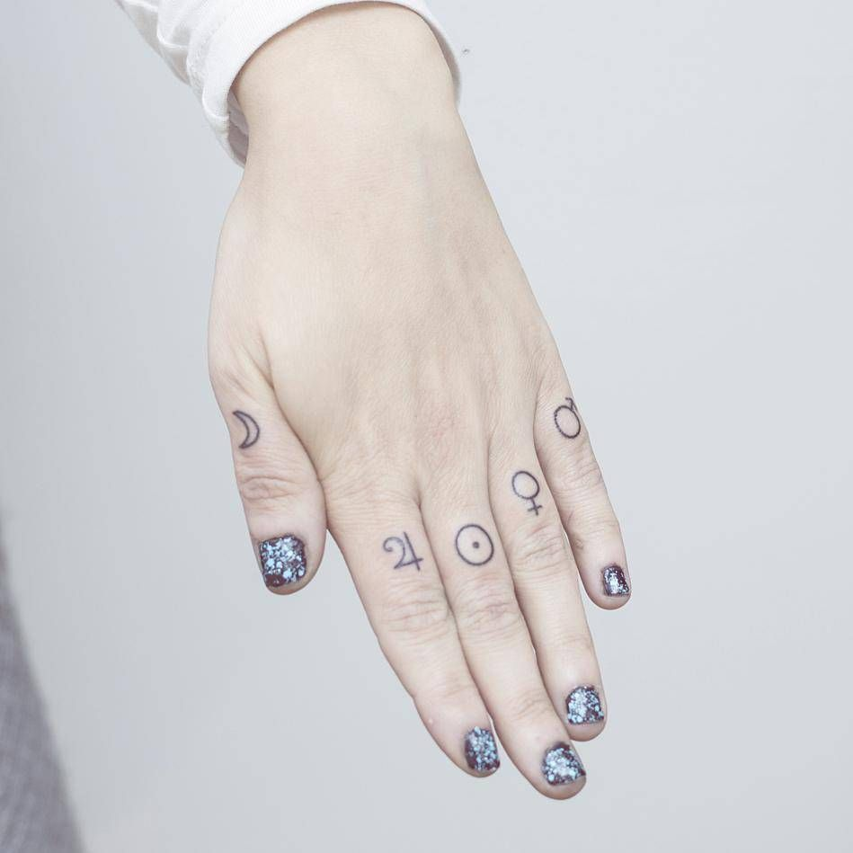 Hand Poked Planet Symbol Tattoos On The Knuckles Knuckle Tattoos Finger Tattoos Planet Tattoos