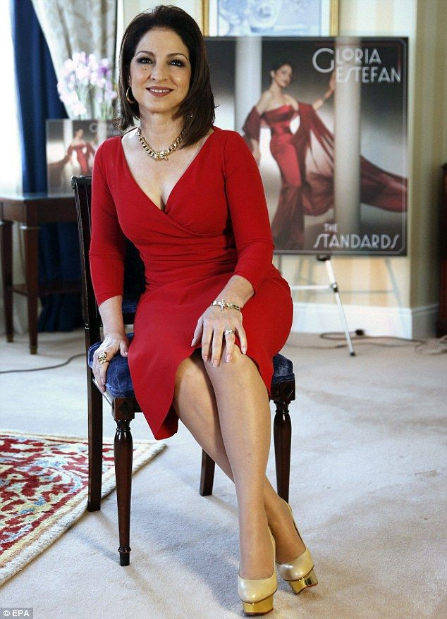 gloria estefan + dress. She survived a severe back injuring from an auto accident with the tour bus.Amazing strong woman.