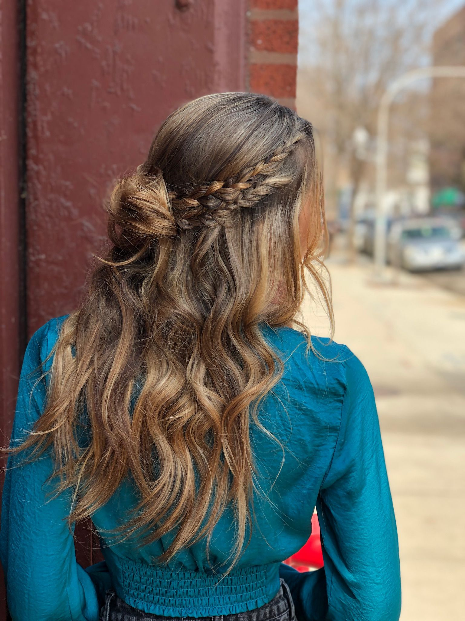 Check Out This Stunning Half Up Half Down Hairstyle With Boho Braids A Messy Bun Waves Our Stylists Are So Tale Bun With Curls Half Up Hair Braided Half Up