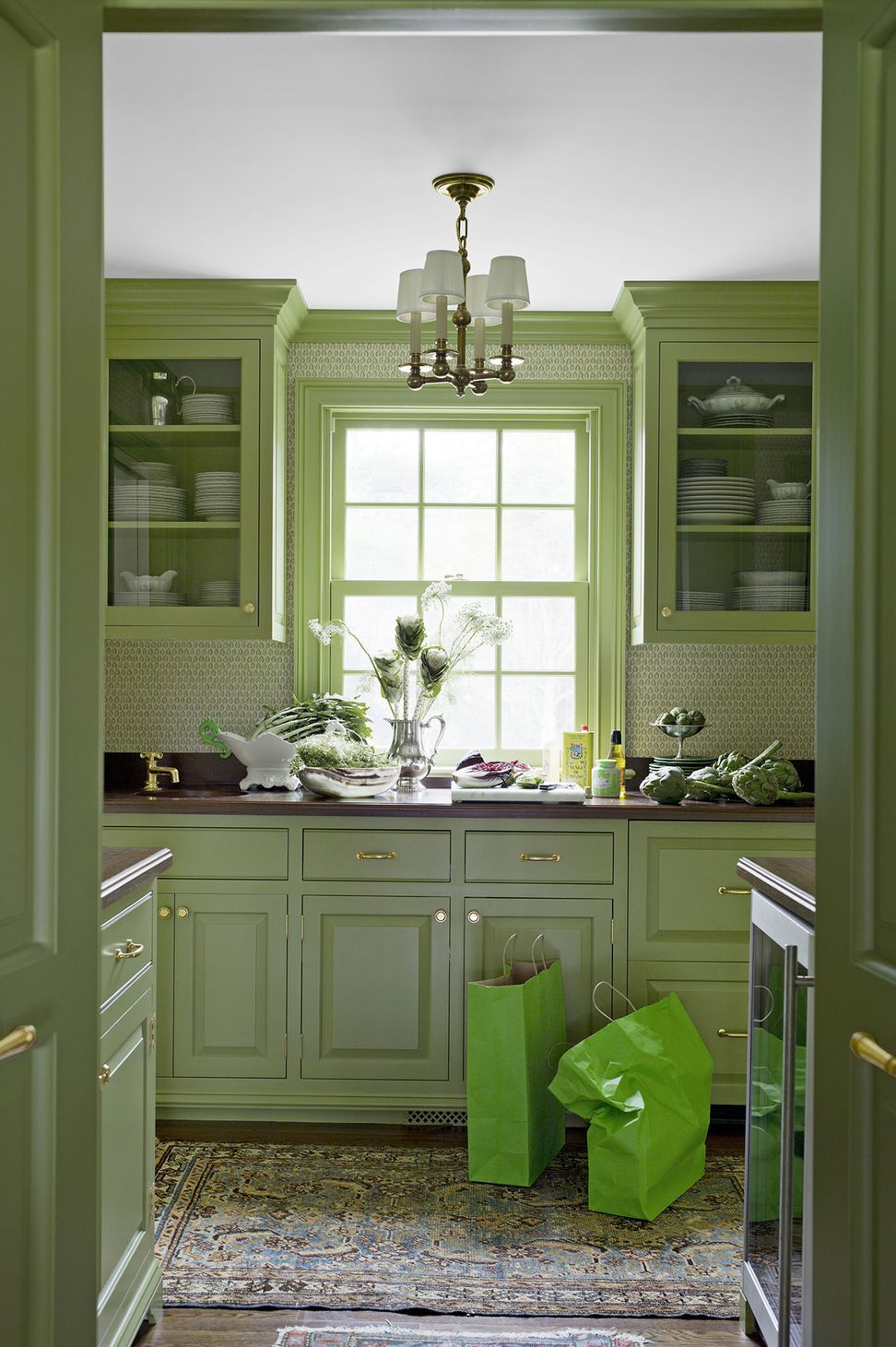 15 Green Kitchens You Re About To Envy Hard Green Kitchen Cabinets Trendy Kitchen Tile Green Countertops