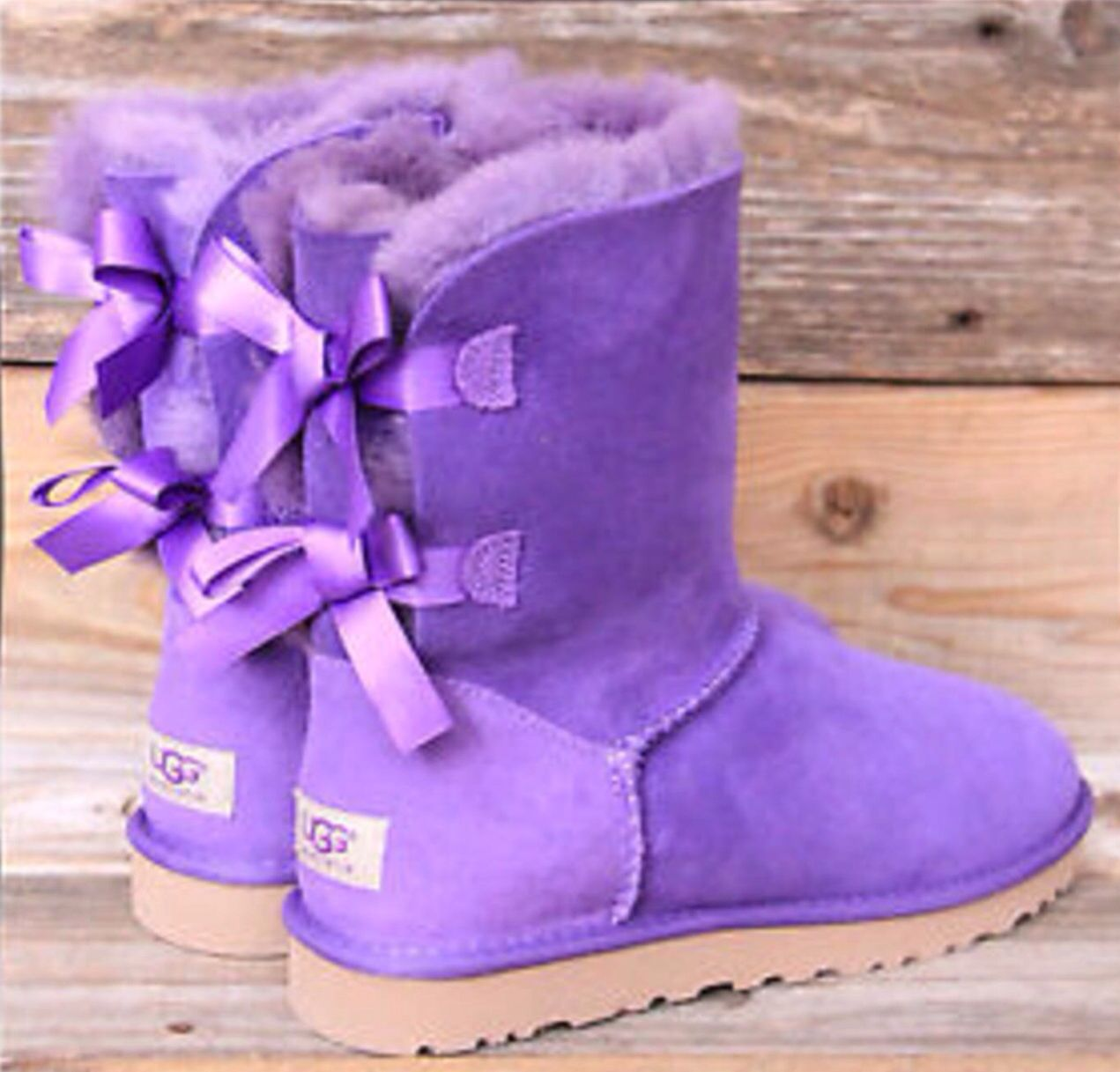 Purple uggs WITH BOWS!i want these for my birthday!