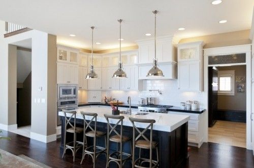 White Kitchen Dark Island white kitchen. dark island. restoration hardware island pendants