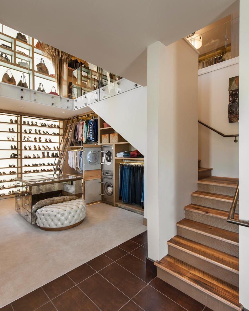 LED Light Paneled Walls In This Two Story Walk In Closet Light  Floor To Ceiling Shelves That Show Off An Extensive Collection Of Shoes And  Handbags.