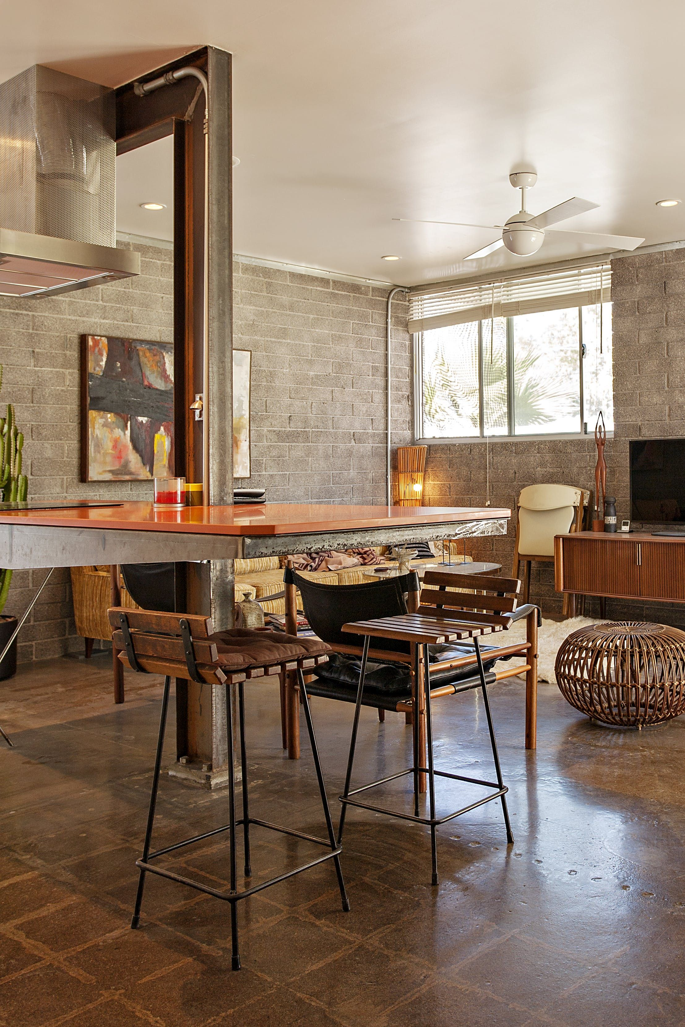 Warm industrial style meets vintage in an arizona condo for Warm industrial decor