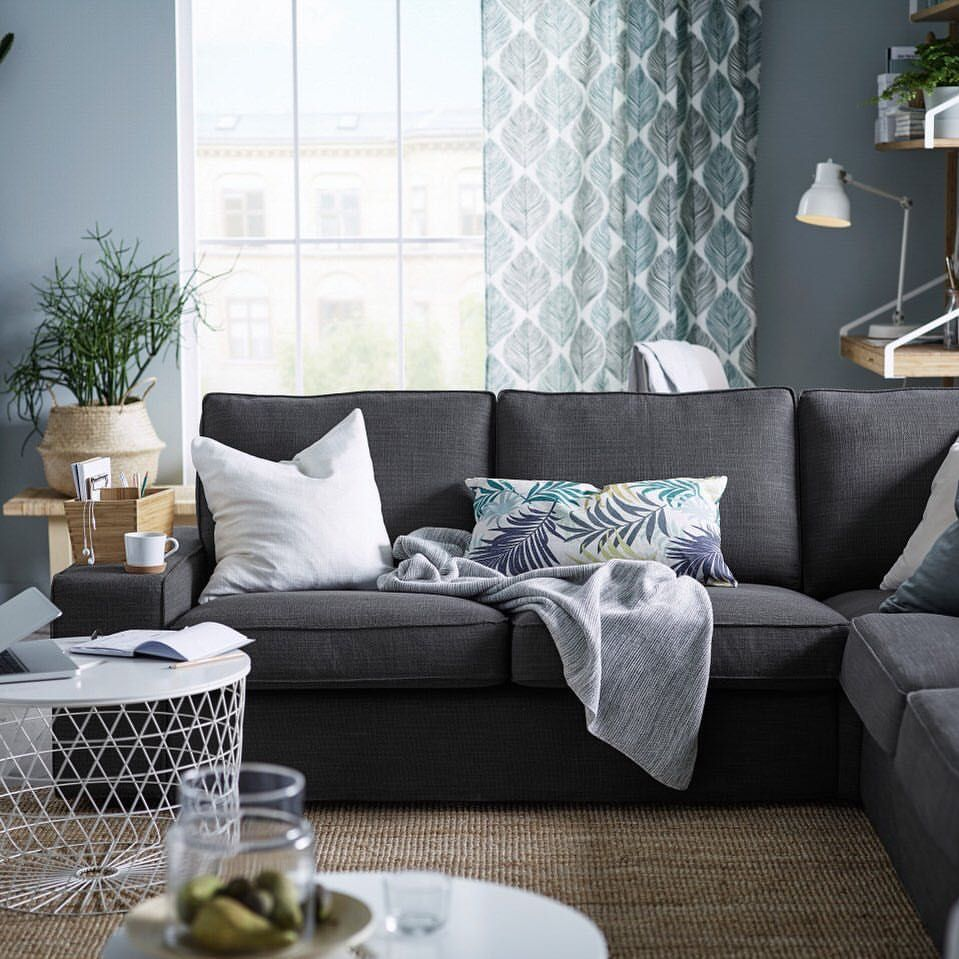 a kivik sectional sofa anchors an airy living room and