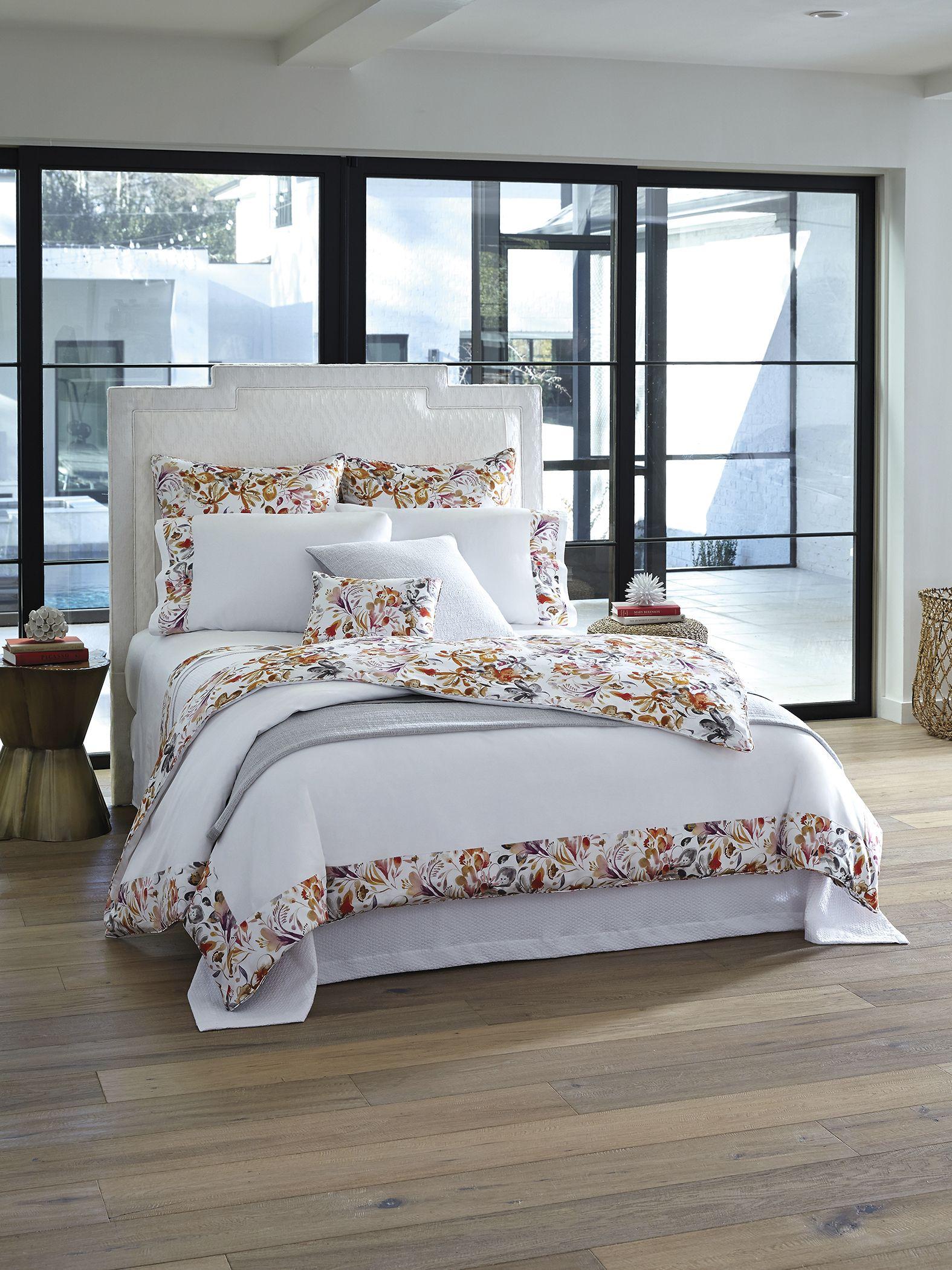 Este's sateen appliqué dresses a bed top with abundant, lush leaves, petals and tendrils of warm color.