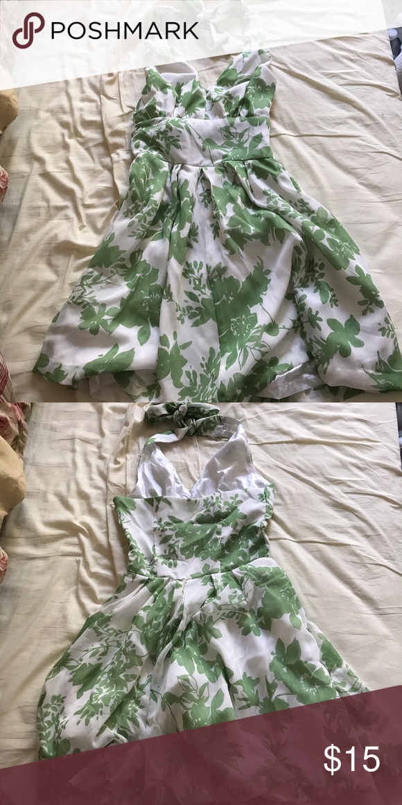 Green and white floral halter dress Never been worn. No tags. Fits as a small. Tie around neck. Dresses Mini