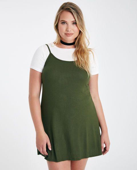 """<p>This cute retro-inspired dress features a double layer 2-fer design with a soft solid knit T-shirt, a ribbed knit slip dress overlay, and a loose, relaxed fit.</p>  <p>Model wears a size 1X.</p>  <ul> <li>Crew Neckline</li> <li>Short Sleeves</li> <li>Pull-on Construction</li> <li>Unlined</li> <li>36"""" From Shoulder to Hem</li> <li>Rayon / Spandex</li> <li>Hand Wash</li> <li>USA</li> </ul>"""