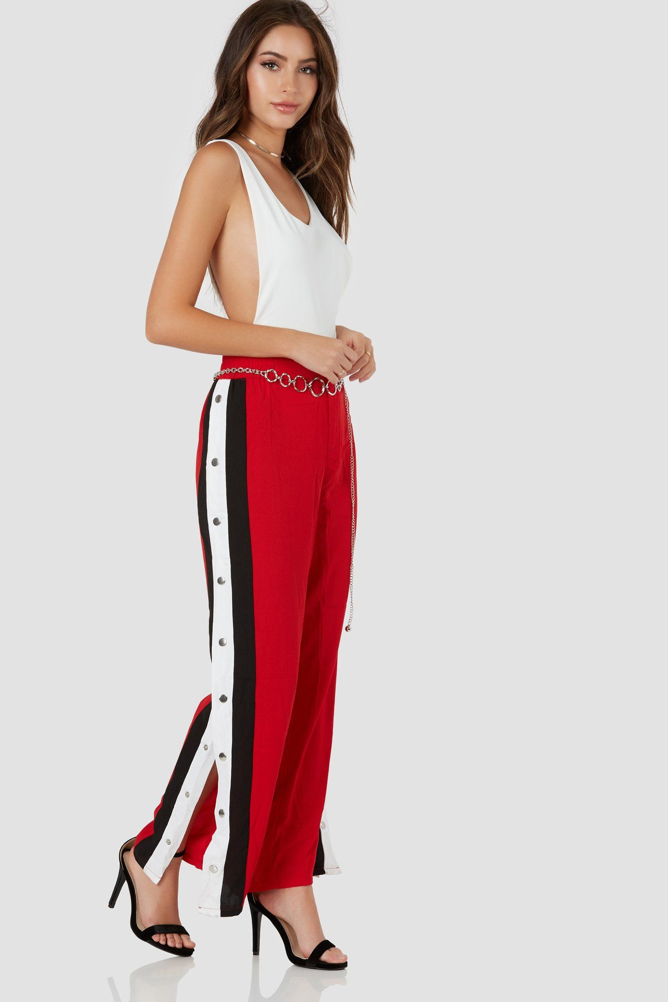 804cecd1a Trendy high rise pants with button zip closure. Contrast stripe detailing  with snap buttons down each side.