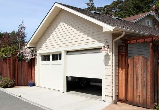 How To Groom Your Garage In One Weekend Garage Doors Residential Garage Doors Garage Door Design