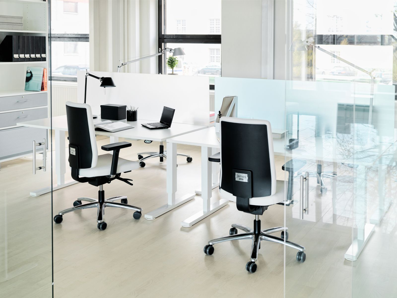 Spot space divider by Martela lets light through and isn't bulky. Yet, it gives the needed privacy in open offices.