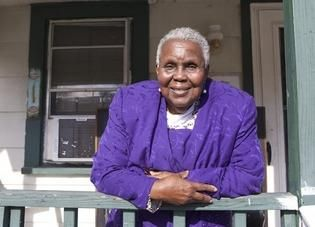 Ethel Sampson stands on her front porch in the Duffyfield community where locals know her as 'Moses.'