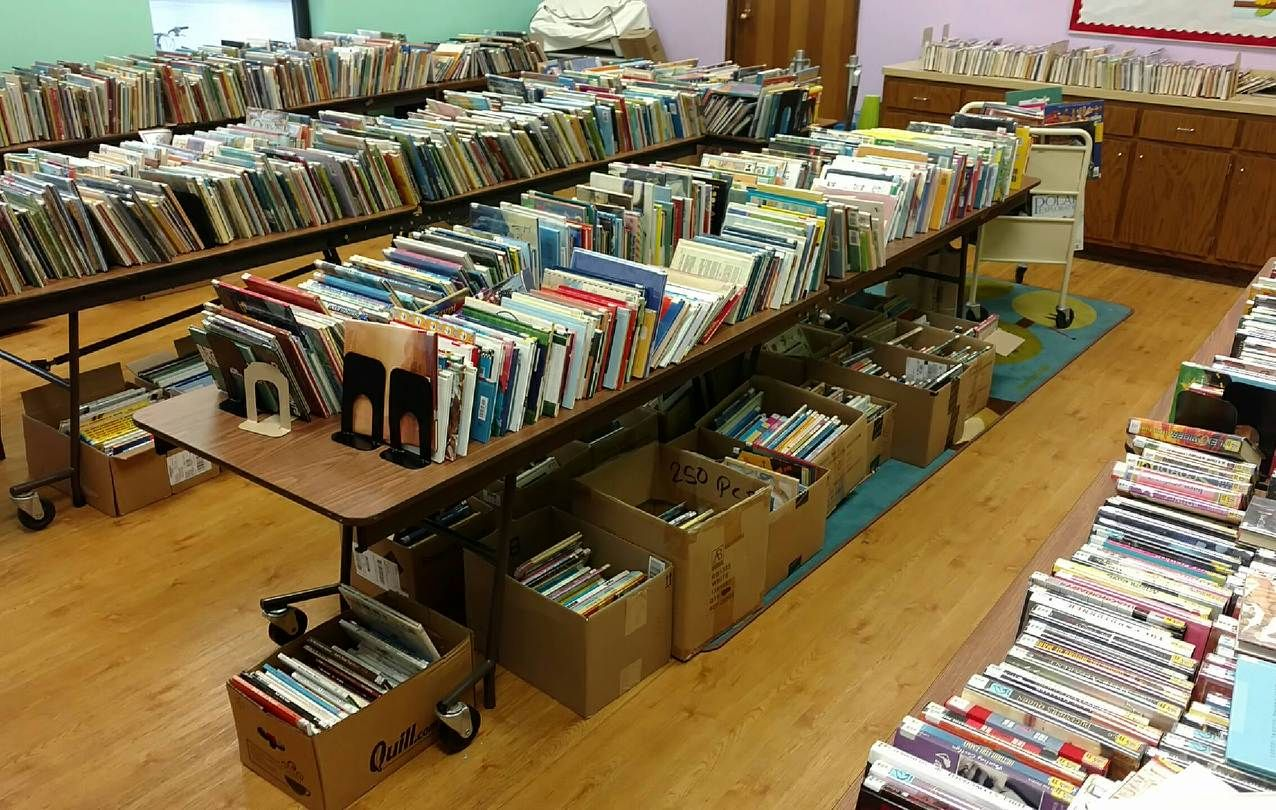 Books at the Fossil Ridge Public Library sale. We help the stories live on at libraries across the US! We pack up all the leftover books, and give them new lives by recycling or getting it them into the hands of another reader. #libraries #booksale #usedbooks