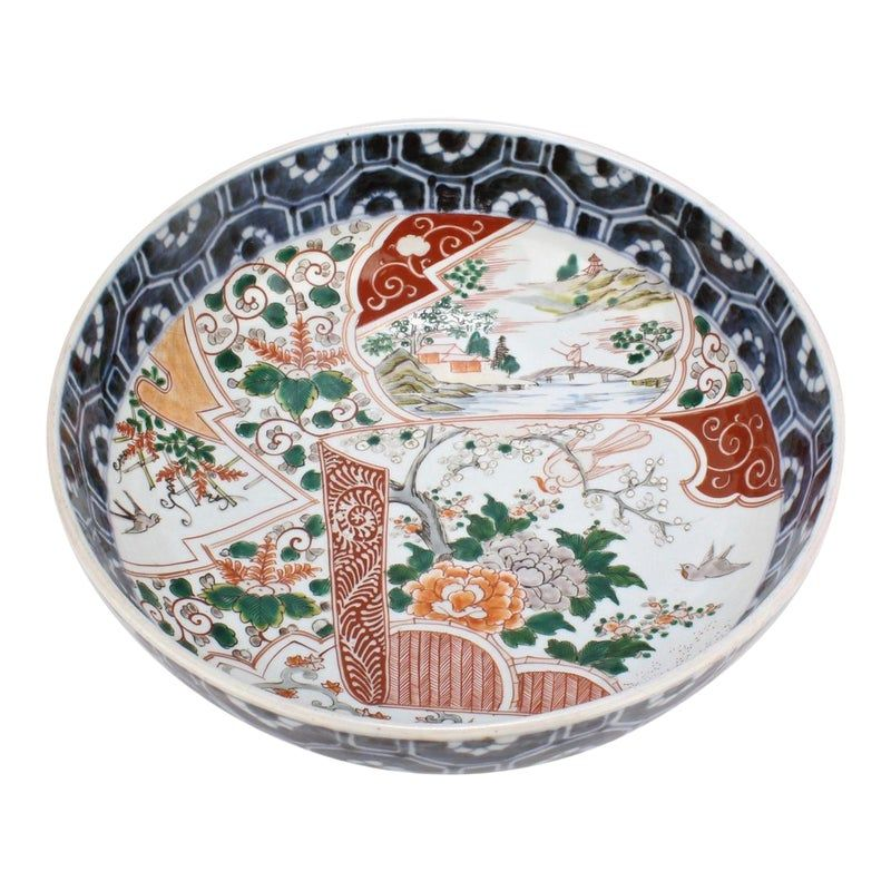 A fine, large antique Japanese Imari bowl.  Decorated with red, blue, green and ochre enamels throughout.   Measures: Diameter: ca. 12 /12 in.