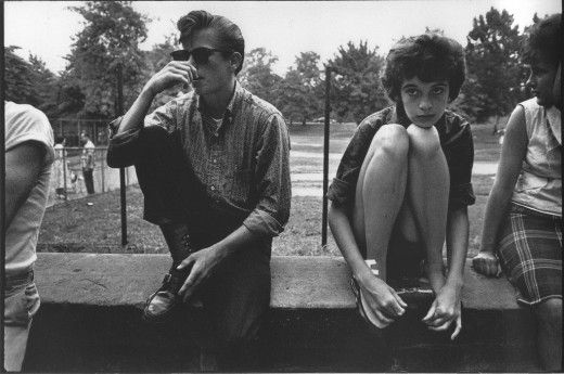 """""""Bruce Davidson's 1959 project Brooklyn Gang is an intimate photographic study of a rebellious Brooklyn teenage gang, who called themselves The Jokers. Not only is Davidson's work a sincere portrayal of troubled teenagers coming of age, but it also acts as a documentation of teenage life during 1950s, exposing the emotional climate of that time period and exposing the dark side of a supposedly innocent time period"""""""