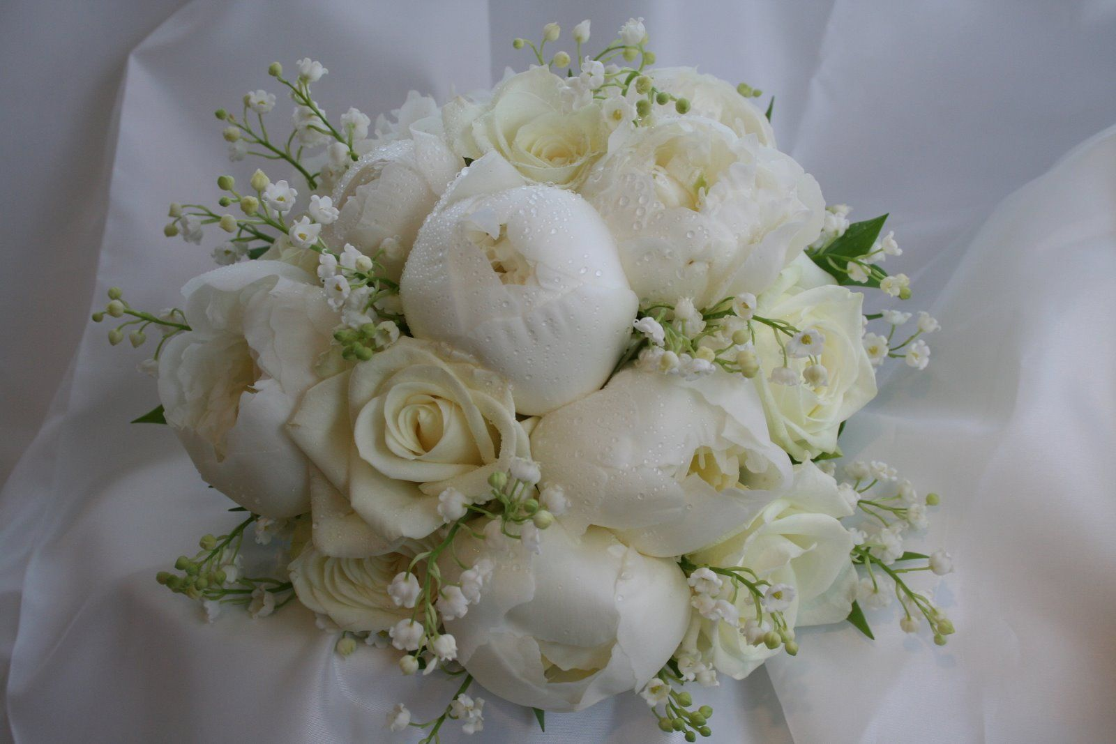 Bridal Bouqet Of White Peonies Roses Lily Of The Valley