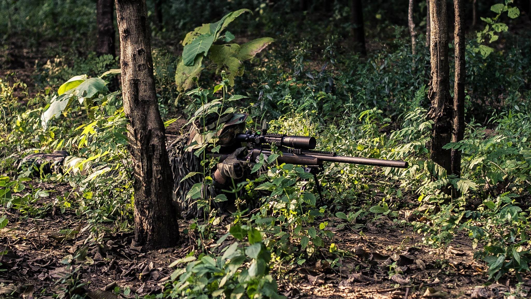 Airsoft player using the Tokyo Marui VSR-10 sniper rifle
