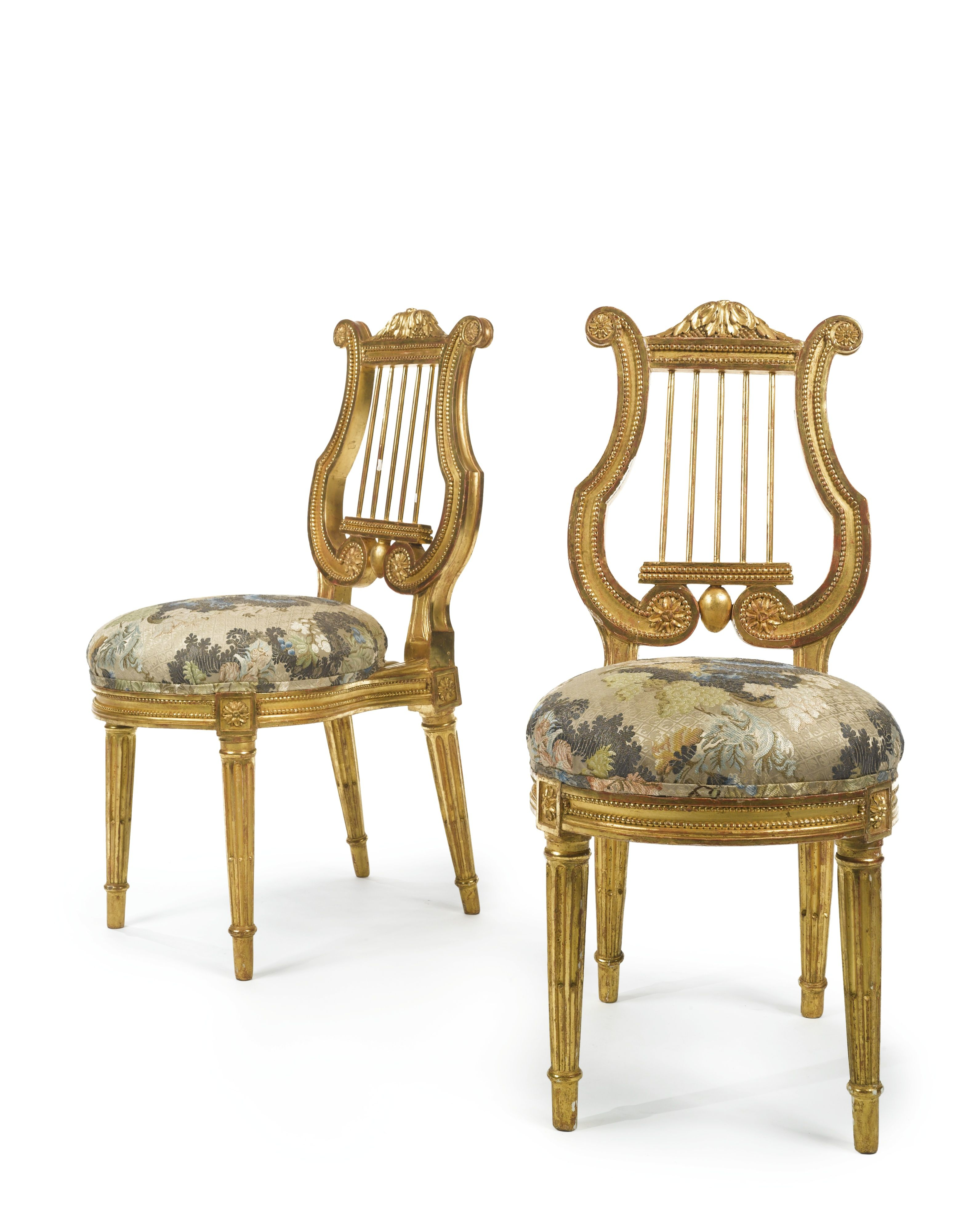 A PAIR OF LOUIS XVI CARVED GILTWOOD CHAIRS circa 1780, stamped L. Delanois. Louis Delanois (1731-1792), maître in 1761 height 34 1/4 in. 87 cm. Estimate  12,000 — 18,000  USD  LOT SOLD. 13,750 USD